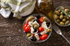 Mediterranean salad with feta cheese and Greek olives top view Stock Image