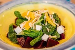 Mediterranean salad, with fresh spinach, orange, beetroot stock photography