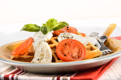 Mediterranean salad with fresh tomatoes, goat cheese, basil and Royalty Free Stock Images