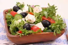 Mediterranean salad, gigantic black olives, sheeps cheese Stock Photos
