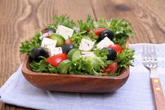 Mediterranean salad, gigantic black olives, sheeps cheese Royalty Free Stock Images