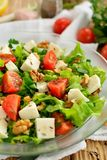 Mediterranean Salad. With lettuce, feta cheese, tomatoes and nuts Stock Photos