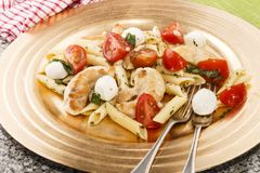 Mediterranean salad with penne, tomato and mozzarella Stock Photos
