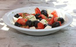 Mediterranean salad on a rustic wooden table  Royalty Free Stock Images
