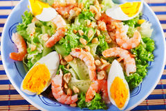 Mediterranean salad with shrimps and eggs Stock Photos
