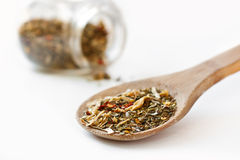 Mediterranean salad spices in oak spoon. And spice jar isolated on white - shallow focus Royalty Free Stock Photo