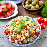 Mediterranean salad - tomatoes, green olives, chickpea Stock Photo
