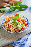 Mediterranean salad - tomatoes, green olives, chickpea Royalty Free Stock Photo