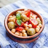 Mediterranean salad - tomatoes, green olives, chickpea Stock Image
