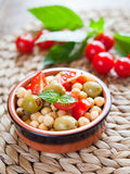 Mediterranean salad - tomatoes, green olives, chickpea Royalty Free Stock Photography