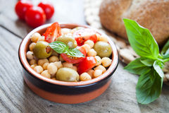 Mediterranean salad - tomatoes, green olives, chickpea Royalty Free Stock Images