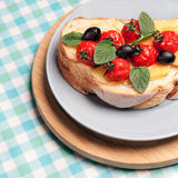 Mediterranean sandwich. With herbs, olives, basil, tomatoes and cheese on a plate Stock Photography