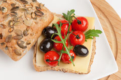 Mediterranean sandwich. With herbs, olives, basil, tomatoes and cheese on a plate Stock Images