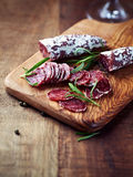 Mediterranean Sausage with Rosemary on a Wooden Chopping Board Royalty Free Stock Photos