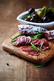 Mediterranean Sausage with Rosemary on a Wooden Chopping Board Royalty Free Stock Photo