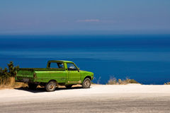 Mediterranean sea. Typical mediterranean scene, old car with blue sea in background Royalty Free Stock Images