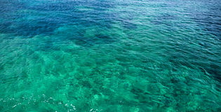 The Mediterranean Sea. Typical emerald and azure colours of the Mediterranean Sea coastline shallow waters Royalty Free Stock Image