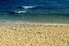 Mediterranean Sea and beach on sunset. Royalty Free Stock Images