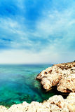 Mediterranean sea coast.  Rock and sea, summer beach paradise wa. Llpaper. Cyprus Stock Photography