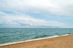 Mediterranean sea coast under cloudy sky Stock Photos