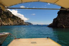 Mediterranean sea cove harbor viewed through arch Corfu Greece Stock Images