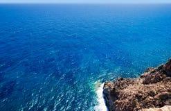 Mediterranean sea foam rocky shore Stock Photography
