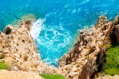 Mediterranean sea foam rocky shore Stock Images