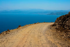 Dangerous turn on road to Gramvousa at Crete. Mediterranean sea and gravel dangerous road, which leads to Gramvousa beach on island of Crete in Greece Royalty Free Stock Photography