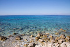 Mediterranean sea in Greece: Ocean background with coast, water Royalty Free Stock Images
