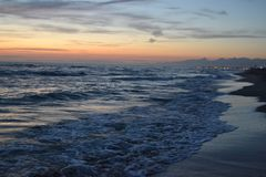 Mediterranean Sea in italy in the evening. Waves Stock Photo