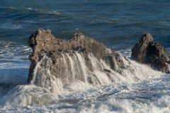 Mediterranean sea. Italy. Splashing waves against rocks Royalty Free Stock Photography