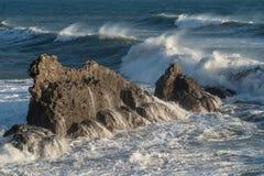 Mediterranean sea. Italy. Splashing waves against rocks Royalty Free Stock Image