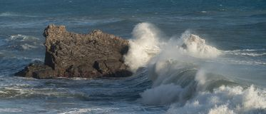 Mediterranean sea. Italy. Splashing waves against rocks Stock Photography