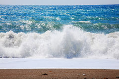 Mediterranean Sea. The Mediterranean Sea with large waves and surf, seen from a shoreline beach in Cyprus Stock Photos