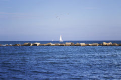 Mediterranean Sea. Lonely yacht with white sail Royalty Free Stock Image