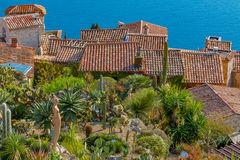 Mediterranean sea and medieval houses in Eze village in France Royalty Free Stock Image