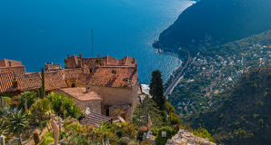 Mediterranean sea and medieval houses in Eze village in France Stock Photos