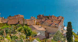 Mediterranean sea and medieval houses in Eze village in France Royalty Free Stock Images