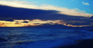 Mediterranean sea with mount Etna. In the background at sunset in winter royalty free stock image