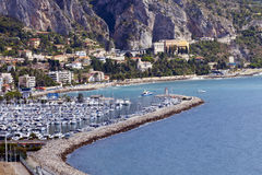 Mediterranean Sea and mountain backdrop in Menton, France Stock Photos