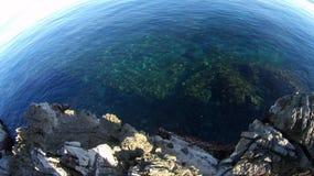Mediterranean sea. Rocky desert beach, sunny winter day Royalty Free Stock Photo