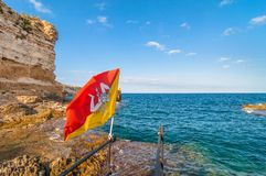 Mediterranean sea and Sicily flag in Syracuse, Italy Royalty Free Stock Images