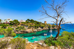 Mediterranean Sea Spain Majorca bay of Cala Pi. Picturesque island scenery, beautiful bay with boats with view of Torre de Cala Pi, Mallorca Spain, Mediterranean Stock Photo