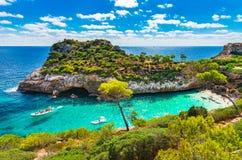 Mediterranean Sea Spain Majorca Beach Bay of Cala Moro. Cala Moro bay beach with turquoise tropical sea water at Majorca Spain, Mediterranean Sea, beautiful Stock Photos