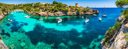 Mediterranean Sea Spain Majorca Cala Pi. Panorama view of the bay beach Cala Pi on Mallorca island, beautiful seaside coast with boats, Balearic Islands, Spain stock photo