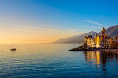 Mediterranean Sea at sunrise, small town and yacht Stock Image