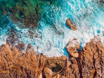 Mediterranean Sea with turquoise water beats on coast of island of Malta. Aerial top view.  royalty free stock images