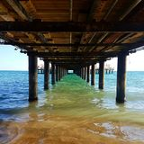 Mediterranean sea under the pier stock photos