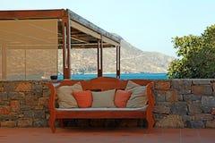 Mediterranean sea view with  outdoor sofa (Greece) Stock Image