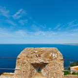 Mediterranean Sea. Views of the Mediterranean Sea through the Battlements of a Medieval Fortress in Italy Royalty Free Stock Photos